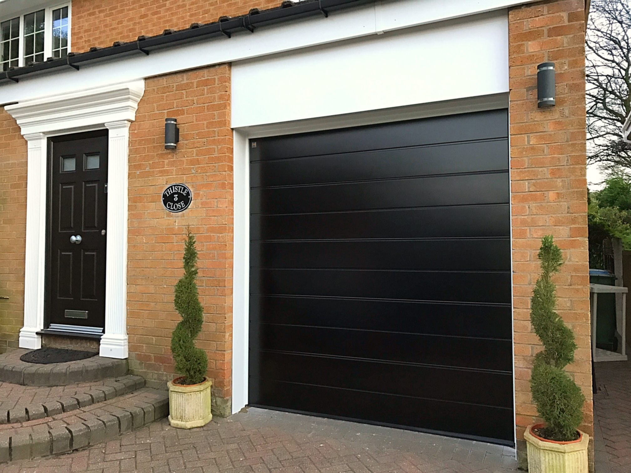 Hormann black sectional garage door pennine garage doors for Garage doors uk