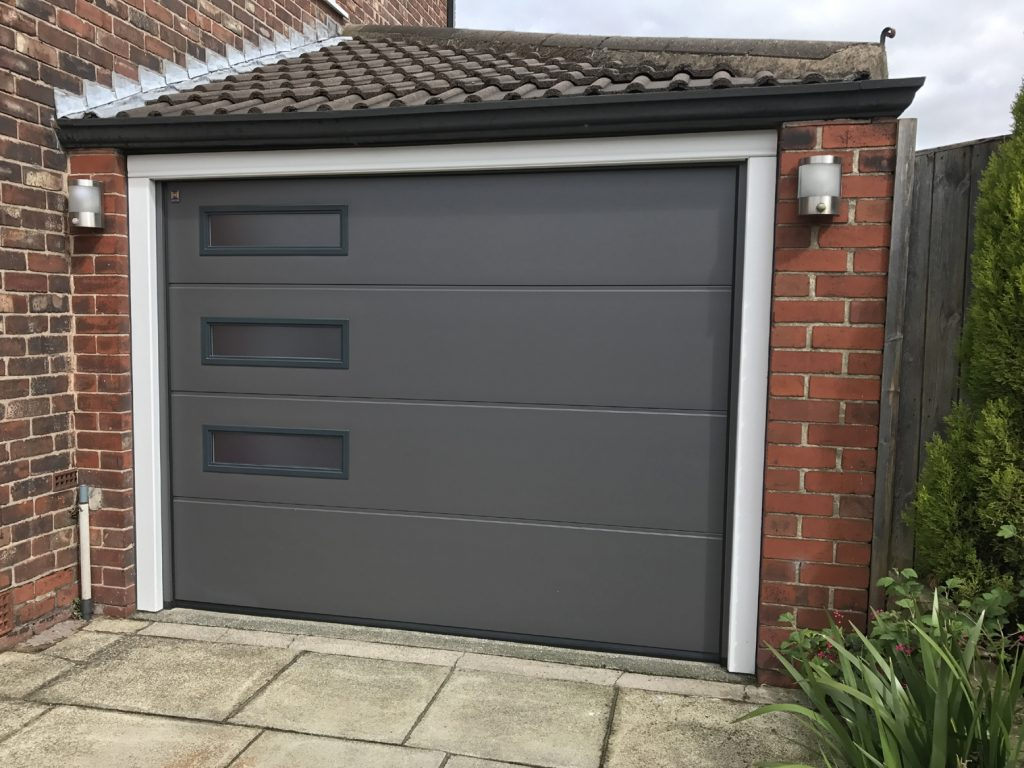 Hormann sectional garage door denton pennine garage doors for Drive through garage door
