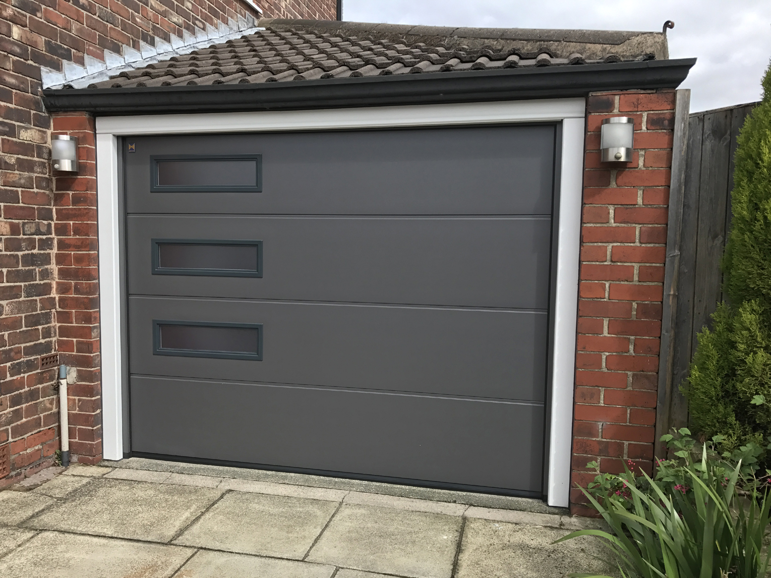 Hormann sectional garage door denton pennine garage doors for Garage door opens on its own