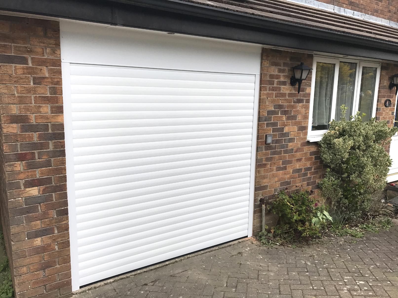 Alluguard roller garage door simmondley pennine garage for Gemini garage door motor manual