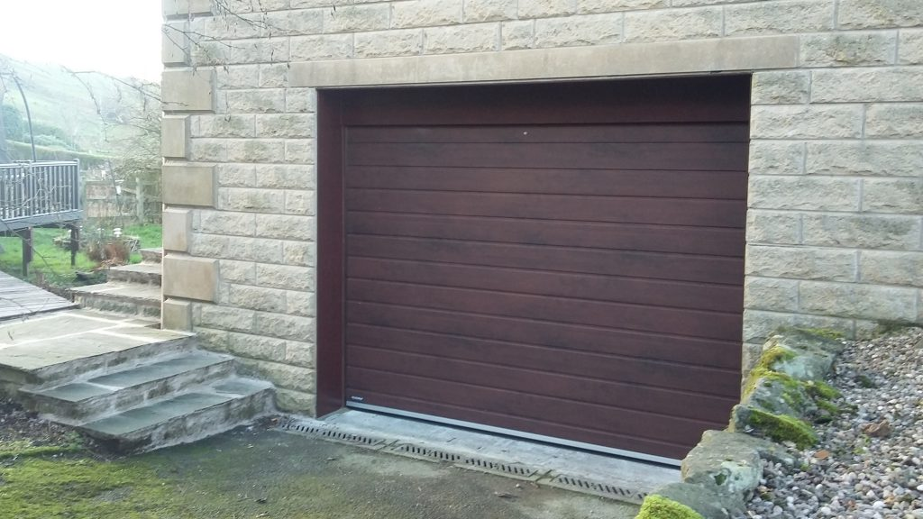 Teckentrup sectional door. Padfield, Glossop